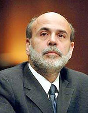 With unemployment high and inflation very low, Bernanke defended the Fed's $600 billion bond-buying program.