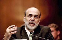 Fed Chairman Bernanke told Congress on Wednesday, that the central bank has no intention of cutting short a $600 billion bond-buying program.