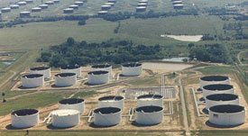 Oil storage tanks at Cushing, OK, are almost filled to their limits.