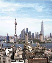 Towering over the Huangpu River, Shanghai is a 21st Century boomtown.